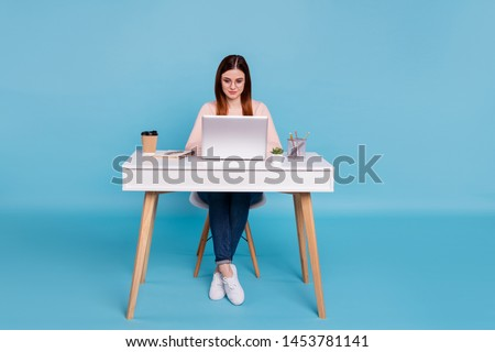 Portrait of nice lovely attractive focused concentrated girl self development preparing annual finance design designer at work place station isolated over bright vivid shine blue background