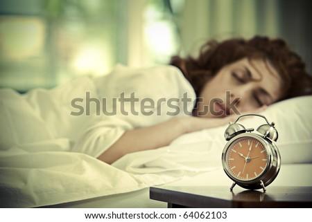 portrait of nice young woman sleeping in her bedroom