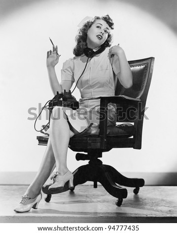 Portrait of nurse talking on telephone