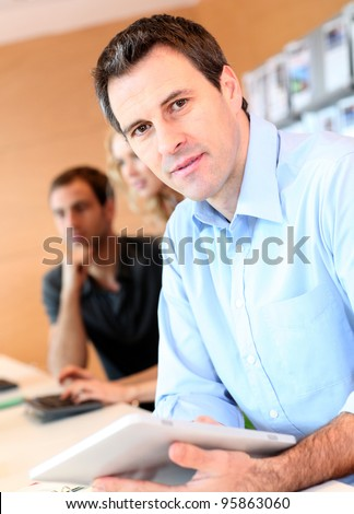 Portrait of office worker with tablet