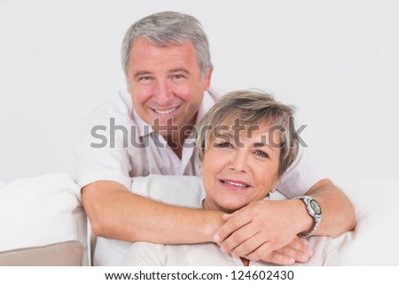 Portrait of old couple in sitting room