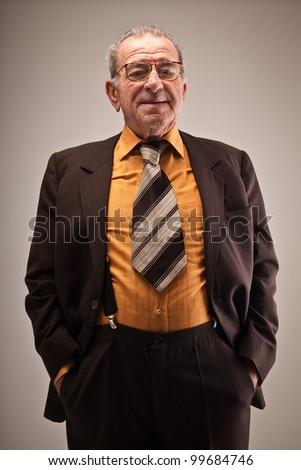 Portrait of old man in suit