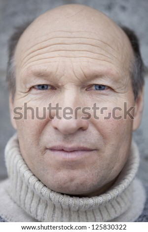 Portrait of old man of 55-60 years. - stock photo