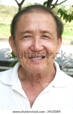 Portrait of old man smiling in the park