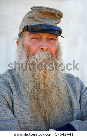 Portrait of old soldier in confederate uniform wearing long white beard