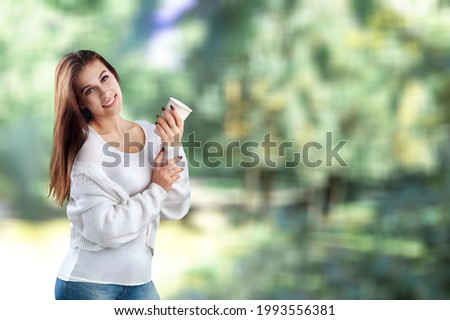 Portrait of one cute young woman walking outdoor.