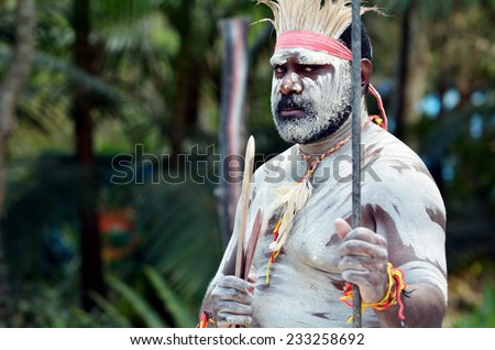 Portrait of one Yugambeh Aboriginal warrior man preform Aboriginal culture martial art during Aboriginal cultural show in Queensland Australia