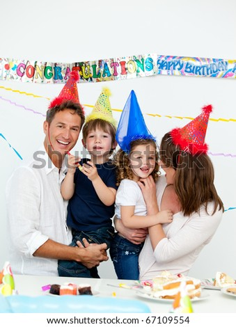 Portrait of parents with their children during a birthday party at home