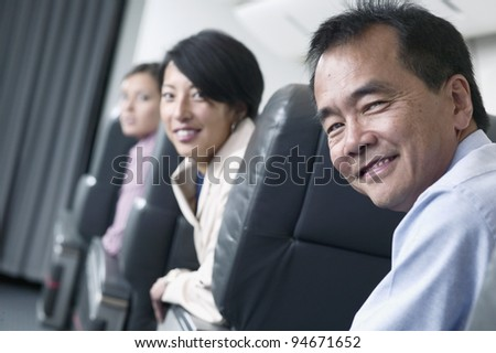 Portrait of passengers on airplane