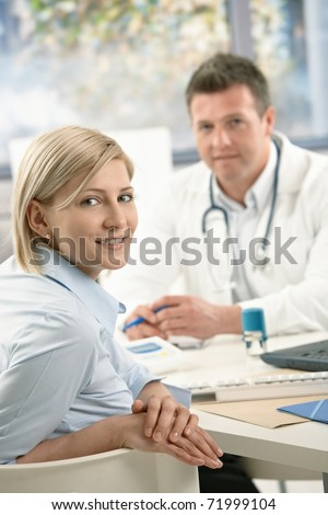 Portrait of patient at doctor's office, smiling at camera.?