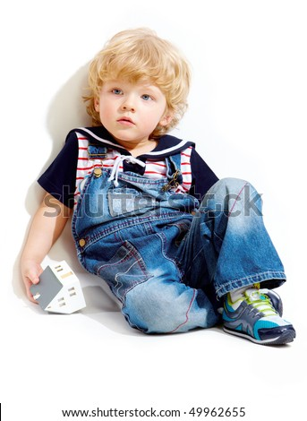 Portrait of pensive kid on white background