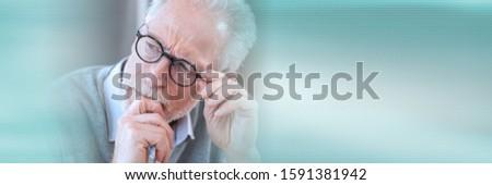 Portrait of pensive senior businessman; panoramic banner