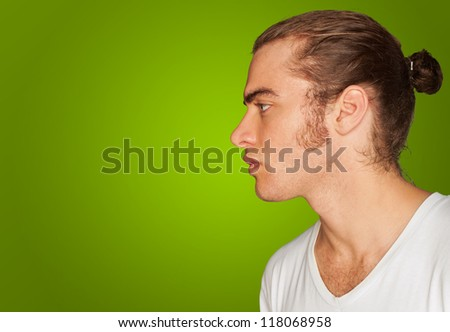 Portrait Of Pensive Young Man On Green  Background