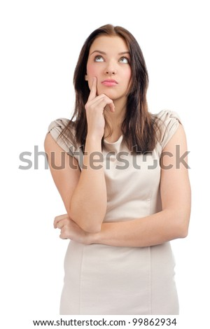Portrait of pensive young woman looking up, over white background