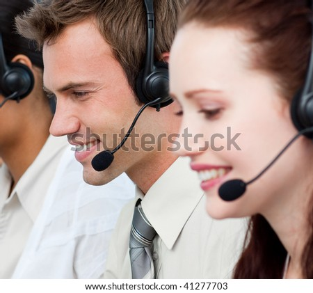 Portrait of people with a headset on working in a call center