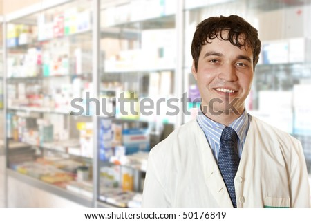 portrait of pharmacist looking at camera - stock photo