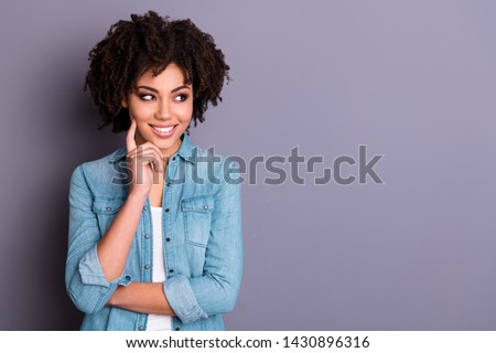 Portrait of positive cheerful cute smart intelligent millennial have different ideas touch finger cheeks face candid satisfied isolated dressed denim modern grey background