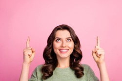 Portrait of positive cheerful girl point index finger up copyspace select suggest adverts promotion indicate sales discount wear modern sweater isolated over pastel color background