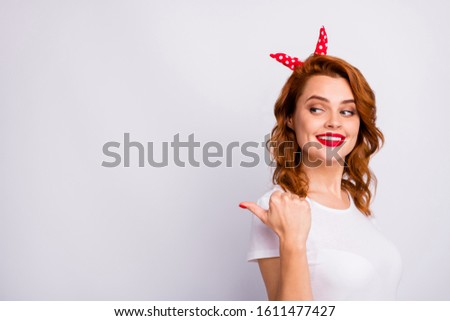 Portrait of positive cheerful girl promoter point forefinger copyspace indicate adverts select suggest promotion wear stylish clothes isolated over white color background