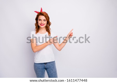 Portrait of positive cheerful girl promoter point index finger copyspace indicate sales discount direct adverts wear stylish outfit isolated over white color background