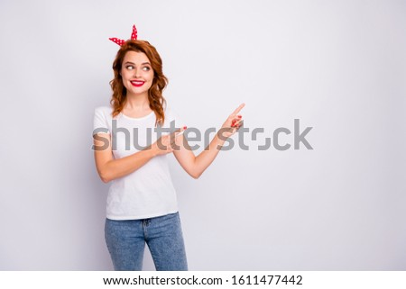 Portrait of positive cheerful girl promoter point index finger copyspace recommend adverts present promotion wear stylish clothes isolated over white color background