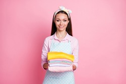 Portrait of positive cheerful wife hold pile stack wash clothes wear good look outfit isolated over pastel color background