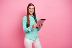 Portrait of positive clever intelligent girl marketer assistant use tablet read document wear formalwear turquoise outfit isolated over pastel color background