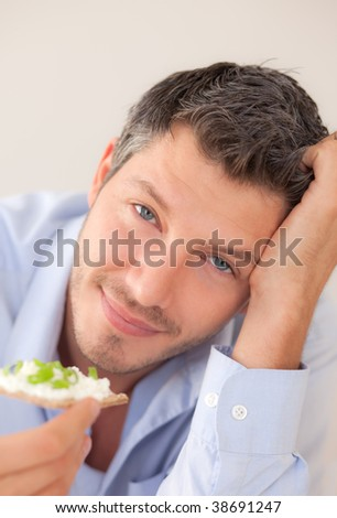 Portrait of Positive smiling man eating healthy nutrition on morning after waking up