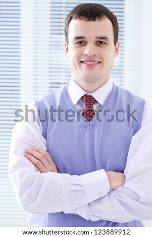 Portrait of positive well-dressed businessman