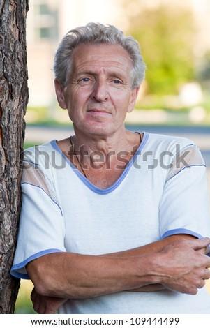 Portrait of positivity senior man outdoor