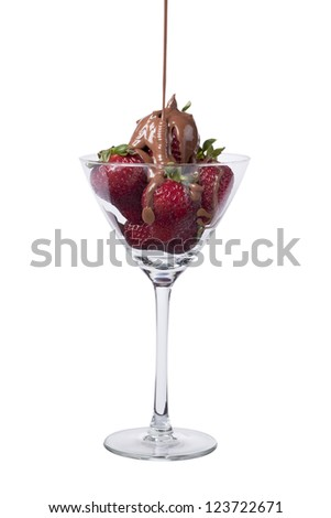 Portrait of pouring chocolate in strawberries on the wine glass isolated on a white background