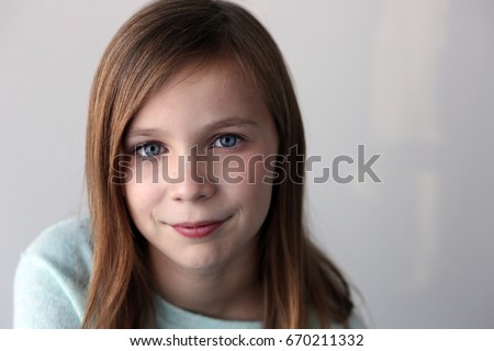 portrait of preteen with blue eyes #670211332
