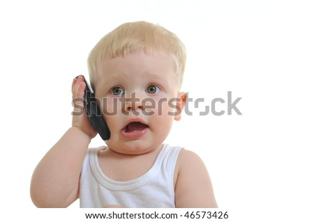 Portrait of pretty baby talking on mobile phone. Isolated over white
