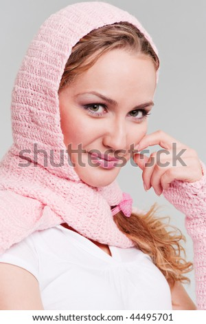 portrait of pretty blonde in pink scarf against grey background