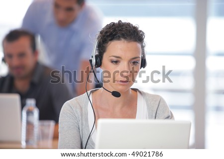 Portrait of pretty business woman with headset
