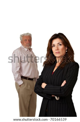Portrait of pretty business woman with sad looking mature man in background.  Isolated on white.