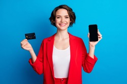 Portrait of pretty cheerful lady demonstrating device bank card pay pass method transfer isolated on vivid blue color background