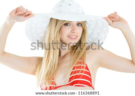 Portrait of pretty cheerful woman wearing red swimsuit and straw hat in sunny warm weather day