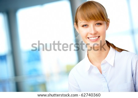 Portrait of pretty female looking at camera with smile