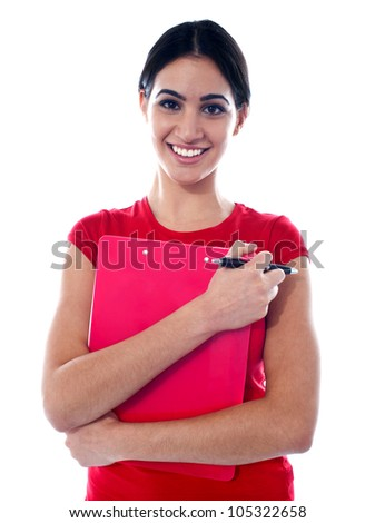 Portrait of pretty female with folder in hands looking at camera and smiling - stock photo