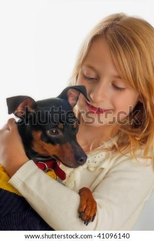 Portrait of pretty girl holding dog
