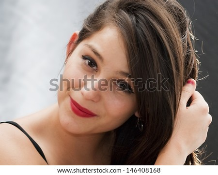 Portrait of pretty girl with back lighting