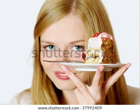 Portrait of pretty  girl with piece of cake. Isolated.