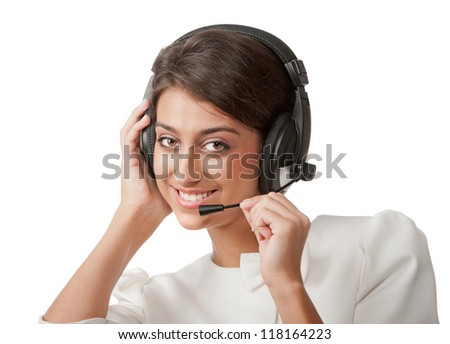 Portrait of pretty happy young girl with headphones posing in studio on white