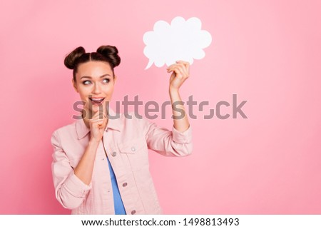 Portrait of pretty impressed youth holding paper card bubble thinking creative screaming wow omg wearing jacket isolated over pink background