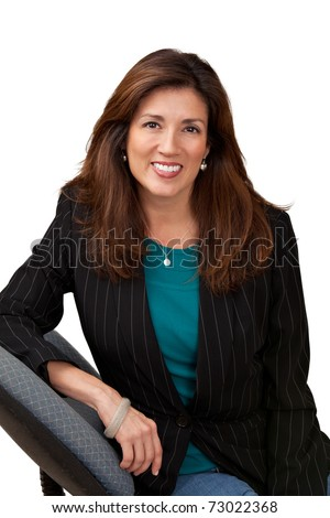 Portrait of pretty mature businesswoman wearing black jacket and blue blouse. Isolated on white sitting in chair.