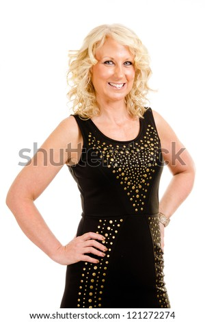 Portrait of pretty middle-aged woman in her 40s dressed for party or night out on the town