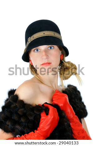 portrait of pretty posing girl in hat and red gloves, isolated on white