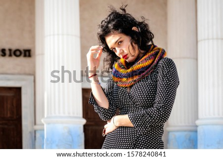 Portrait of pretty pretty young girl outdoors on a sunny day