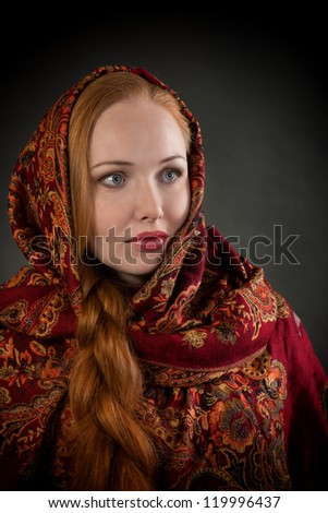 Portrait of pretty Slavonic girl with red braided hair, looking away